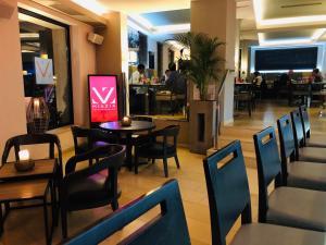 Restaurant ou autre lieu de restauration dans l'établissement Hotel Mia Zia