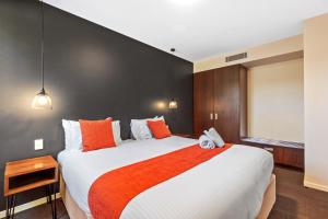 A bed or beds in a room at Altitude On Montville