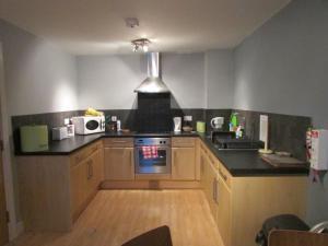A kitchen or kitchenette at Cheltenham Luxury Apartments