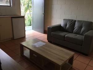 Гостиная зона в Koala Beach Resort Cairns
