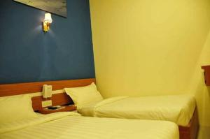 A bed or beds in a room at Venia Hotel Batam