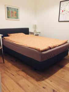 Ein Bett oder Betten in einem Zimmer der Unterkunft Ferienhaus am Glückstädter Hafen