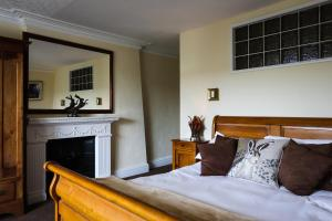 A bed or beds in a room at Harefield Hall