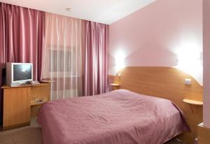 Кровать или кровати в номере Гостиница Луна