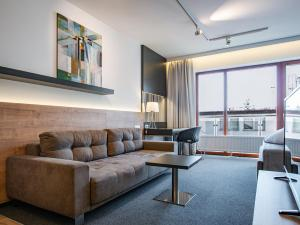 A seating area at TATRA SUITES Luxury Studio A302