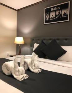 A bed or beds in a room at Yellow Ribbon Hills Boutique Suites