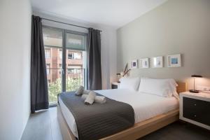 Cama o camas de una habitación en Gaudi Flats