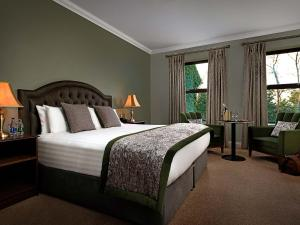 A bed or beds in a room at Oranmore Lodge Hotel Conference And Leisure Centre Galway