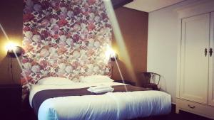 Un ou plusieurs lits dans un hébergement de l'établissement Hotel Zilt