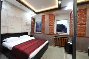A bed or beds in a room at Hotel Kirpich