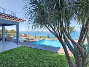 The swimming pool at or near Villa Enjoy Sea by MHM