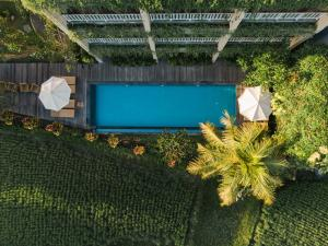 A view of the pool at Byasa Ubud or nearby