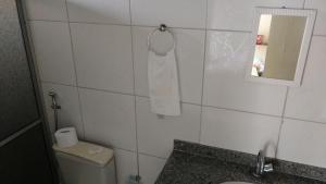 Um banheiro em Flat Terra do Sol