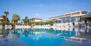 The swimming pool at or near Hotel Villa Olivo Resort