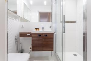 Łazienka w obiekcie Forest Hamptons Apartment Sopot Aquapark