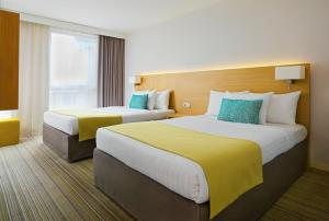 A bed or beds in a room at Courtyard by Marriott Montpellier