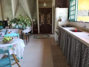 A kitchen or kitchenette at Eco Olinda B&B