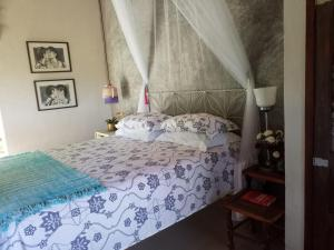 A bed or beds in a room at Eco Olinda B&B