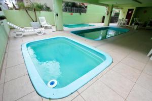 A piscina localizada em Ilha Sol Praia Hotel ou nos arredores
