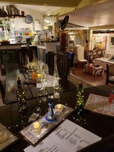 Restaurant ou autre lieu de restauration dans l'établissement Chez Marine Guest House