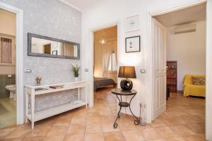 Coin salon dans l'établissement Rome All In Apartments