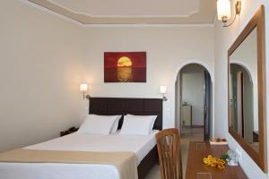 Un ou plusieurs lits dans un hébergement de l'établissement Hotel Kaiser Bridge