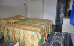Un pat sau paturi într-o cameră la Complex Domneasca