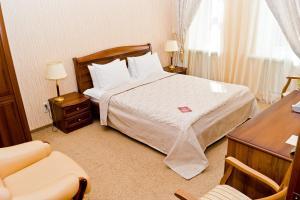 Кровать или кровати в номере Частная резиденция Богемия