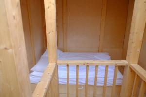 Кровать или кровати в номере Парк Никола Ленивец