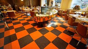Ein Restaurant oder anderes Speiselokal in der Unterkunft Hotel Glockenhof Zürich