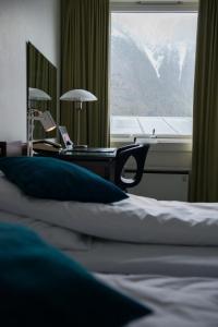 En eller flere senger på et rom på Klingenberg Hotel