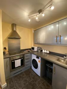 A kitchen or kitchenette at Broad Gauge Suite