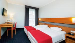 Vuode tai vuoteita majoituspaikassa Hestia Hotel Ilmarine