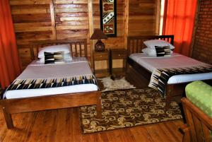 A bed or beds in a room at Ruhija Gorilla Lodge