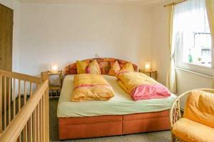 A bed or beds in a room at Pension im Ostseebad Sellin