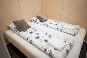 A bed or beds in a room at Welcome Holiday Home