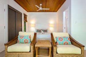 A bed or beds in a room at Heron Island