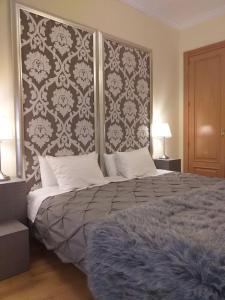 Cama o camas de una habitación en Martin Gamero Apartments
