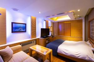 A television and/or entertainment centre at WATER HOTEL Cy (Audlt Only)