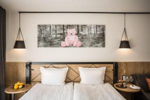 A bed or beds in a room at Rila Hotel Borovets