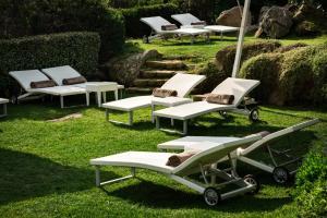 Um jardim em Grand Hotel Ma&Ma Resort