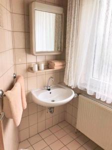 Ein Badezimmer in der Unterkunft Hotel Recke