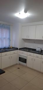 A kitchen or kitchenette at Apartamentos Turisticos Avenue Park
