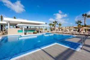 The swimming pool at or near Hotel Riu Chiclana - All Inclusive