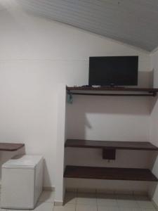 A television and/or entertainment center at Hotel Praia do Encanto