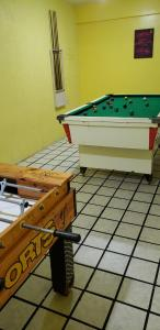A pool table at JR Hotel