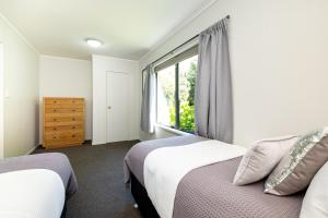 A bed or beds in a room at Lawn Cottages