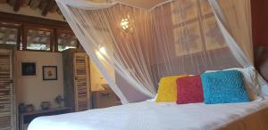 A bed or beds in a room at Luxury Bungalows Praia do Espelho