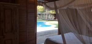 A view of the pool at Luxury Bungalows Praia do Espelho or nearby