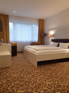 Ein Bett oder Betten in einem Zimmer der Unterkunft Hotel Thermalis
